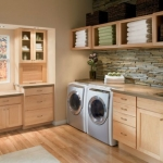 Beautiful-laundry-room-with-ample-storage-and-shelving-room